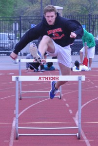 Evan Carpenter goes through a hurdles workout at a recent Troy Athens track practice. The senior has  gone 14.8 already this season in the 110 hurdles. Staff Photo | Dan Stickradt