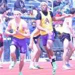 FINAL LEG: Auburn Hills Avondale's Trevon Salter hands off to Dylan Chapman during a leg on the sprint medley relay. The Yellowjackets won three relays and finished third at the West Bloomfield Invitational.