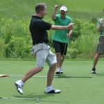 CELEBRATE: Rob Beniesz (black shirt)celebreats after sinking a putt at the 2010 Thomas richards Charity-MattMoscato Charity Golf & Fundraiser at Westwynd golf Course. File Photo | Dan Stickradt