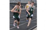 PACK LEADER: Lake Orion's TJ Carey (left) and Justin Prawdzik exchange are two of the top performers fro the the Dragons, who are eying league, regional and county crowns this season.