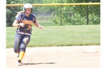 AROUND THEWAY: clarkston'sMegan Hastings rounds second base and heads towards third during the Wolve'sDivision 1 regional semifinal Saturday against Romeo. Staff Photo | Dan Stickradt