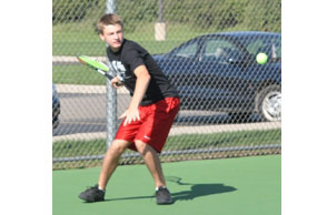 SWAT PATROL: Holly sophomore Parker Rowse plays No. 1 doubles for the Bronchos and is part of a team going after its 20th straight league title. Staff Photo | Dan Stickradt
