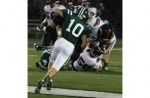 COLLISION COURSE: Lake Orion&#039;s Nick Booker (No.10) knocks down Troy&#039;s Drew Braun during Friday&#039;s OAA Red Division clash. Photo | Larry McKee, www.lmckeephotography.com. To purchase photos from this gallery, e-mail  lmckeephotograpohy@comcast.net