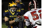ON THE MOVE: Clarkston's Ian Eriksen rushed for 204 yards on 42 carries in helping the Wolves upend Grand Blanc 35-19 for a Division 1 district championship Friday. Photo |Larry McKee, www.lmckeephotography.com, lmckeephotography@comcast.net