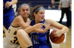 MINE, NO MINE!: Rochester's Anne Tucker (right) and Oxford's Alicia Vasquez battle for the ball during Thursday's OAA White Division contest. Photo } Ken Swart