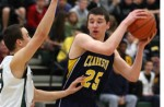 LOOKING PAST: Clarkston's Mike Nicholson and the Wolves slipped past Lake Orion's Roman Kuster and the Dragons in Monday's Class A district opener. Photo | Dan Stickradt.