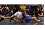 WRESTLING: Catholic Central joins elite company by winning fifth straight Oakland County title