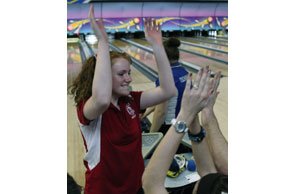 HIGH FIVES: Holly's Heidi Martin had plenty of reasons to celebrate this past winter and the latest is earning a spot on the All-North Oakland Area Girls Bowling Team. File Photo | Larry McKee, www.lmckeephotography.com.