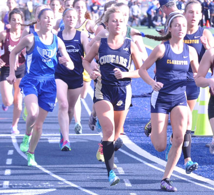 Keeping pace: Waterford Our LAdy of the Lakes' Tessa Fornari (far left), Rochester Stoney Creek's Nicole Kowalchick and Clarkston's Lynsie Gram fight for position during the 1,600 meters at Friday's Oakland County championships.