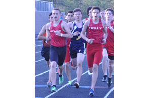 PACK LEADERS: Holly's Dilon Lemond (left) and Vince Cantu lead the 1,600 meters after the first lap at Wednesday's Flint Metro League meet. Holly took four of the top five slots in the race. Staff Photo | Dan Stickradt